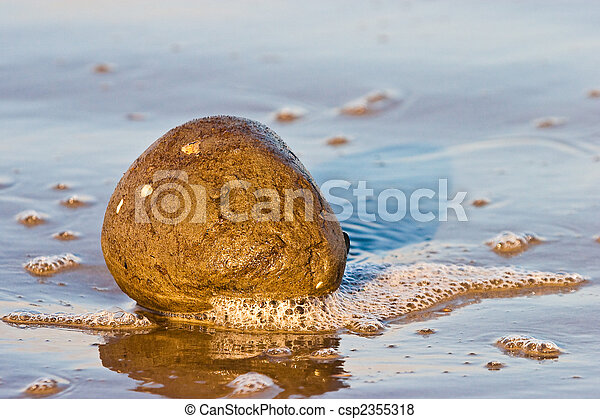 Lump of sand in the water - csp2355318
