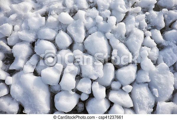 Lumps of snow and ice frazil on the surface of the freezing river water in early winter - csp41237661