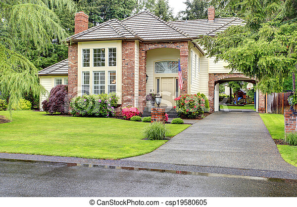 Luxury brick house with siding trim - csp19580605