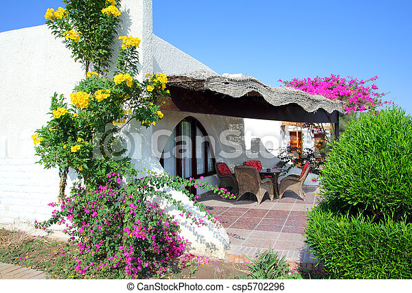 luxury bungalow in tropical hotel - csp5702296