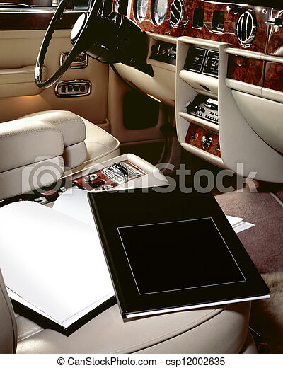 Luxury car interior with books on seat - csp12002635
