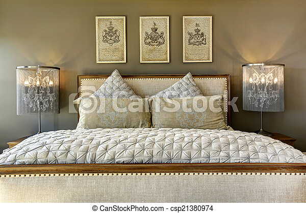 Luxury carved wood bed with pillows - csp21380974