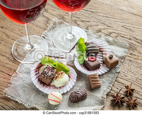 Luxury chocolate candies with two glasses of wine - csp31881583