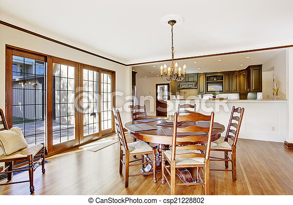 Luxury dining room with round table and chairs - csp21228802