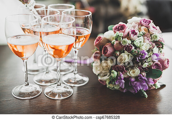 Luxury glasses with champagne on the table - csp67685328