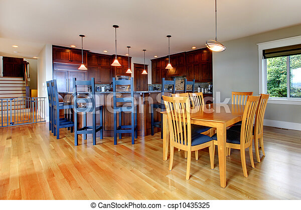 Luxury home kitchen and dining room with open floor plan. - csp10435325