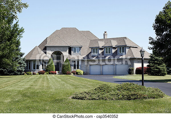 Luxury home with three car garage - csp3540352