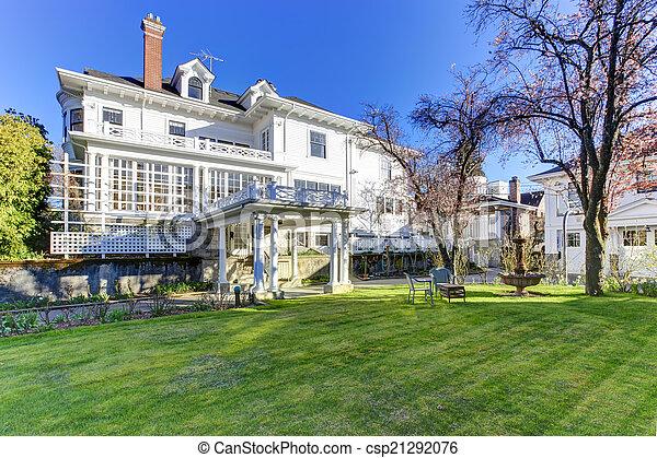 Luxury house with backyard garden - csp21292076