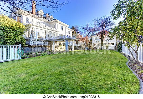 Luxury house with backyard garden - csp21292318