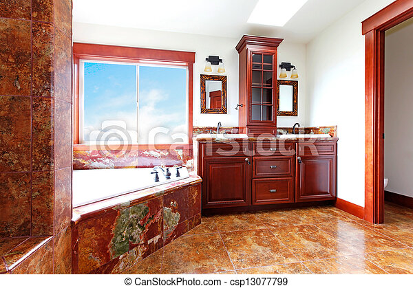 Luxury new home bathroom with red marble and mahogany wood. - csp13077799