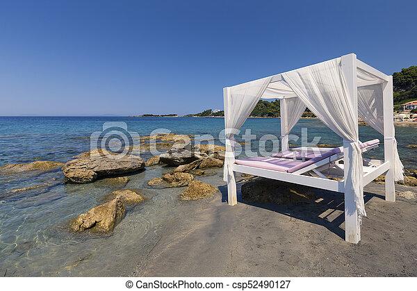 Luxury white bed on a beach in Mediterranean coast - csp52490127