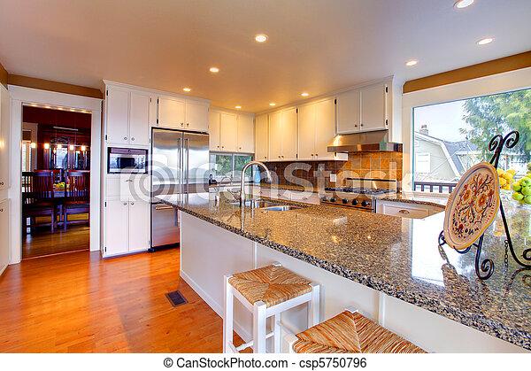 Luxury white kitchen with beautiful granite - csp5750796