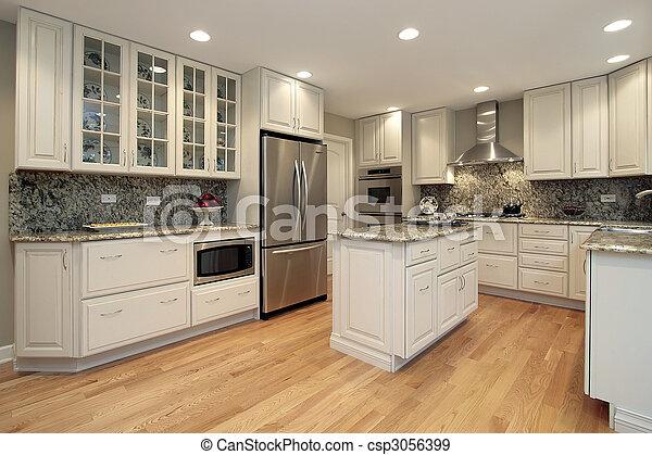 Cocina con armarios de colores claros - csp3056399