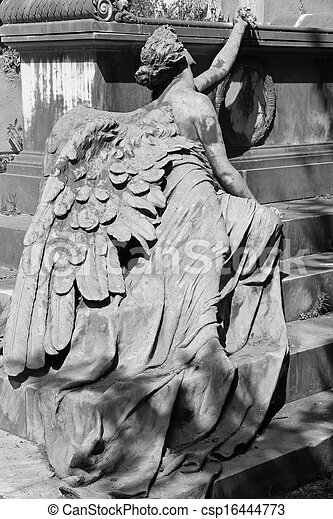 Lying angel sculpture at the tomb on monumental cemetery of Staglieno, Genoa, Italy, Europe - csp16444773