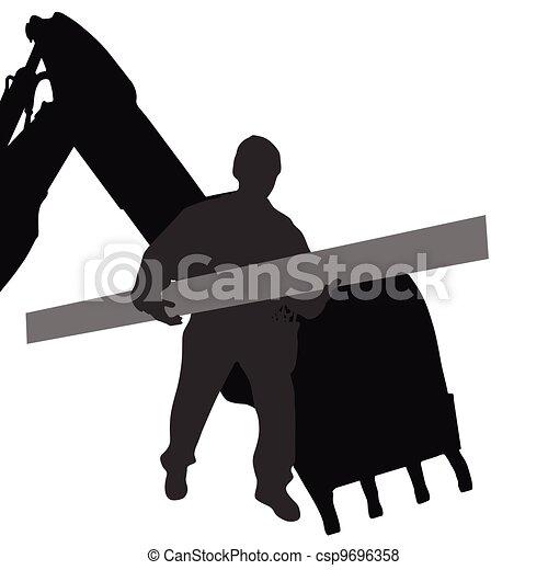El trabajador lleva material por máquina - csp9696358