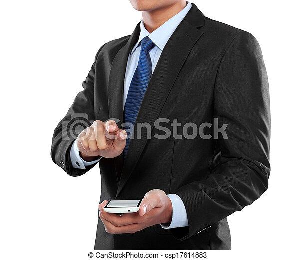 Hombre de negocios sosteniendo un teléfono móvil inteligente y una pantalla conmovedora - csp17614883
