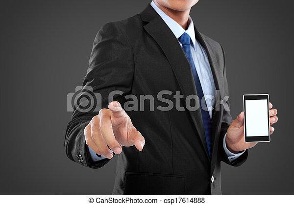 Hombre de negocios sosteniendo un teléfono móvil inteligente y una pantalla conmovedora - csp17614888
