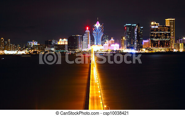 Macao cityscape with famous landmark of casino skyscraper and bridge - csp10038421