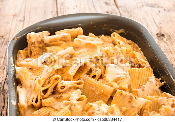 Macaroni with meat baked with cheese - csp88334417