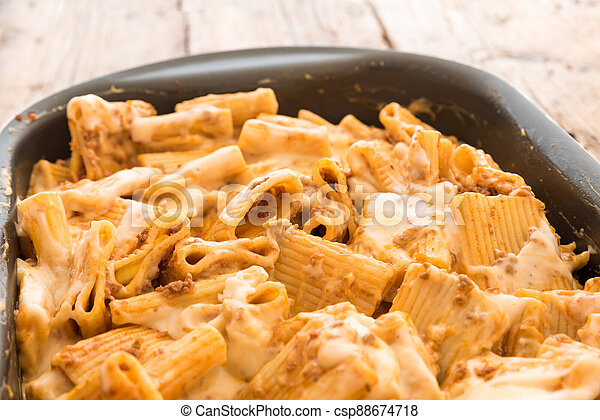 Macaroni with meat baked with cheese - csp88674718