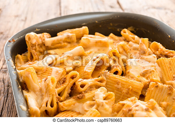 Macaroni with meat baked with cheese - csp89760663