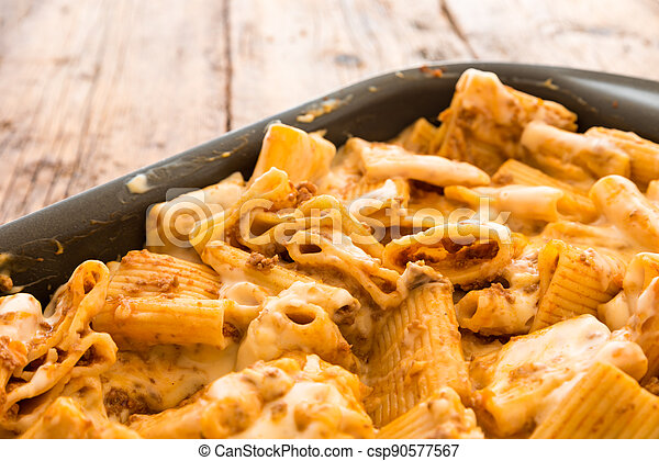 Macaroni with meat baked with cheese - csp90577567