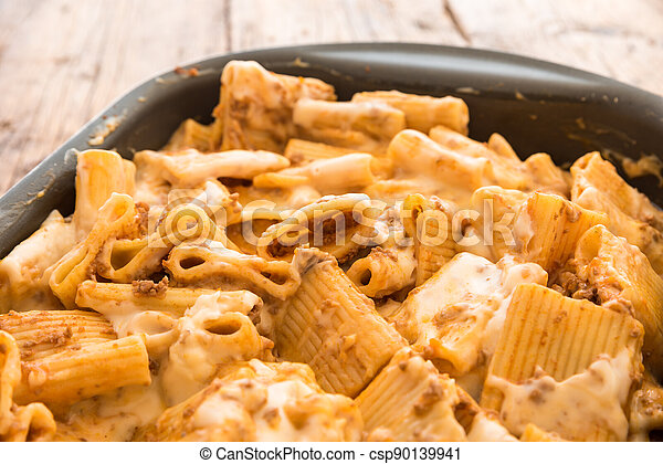 Macaroni with meat baked with cheese - csp90139941
