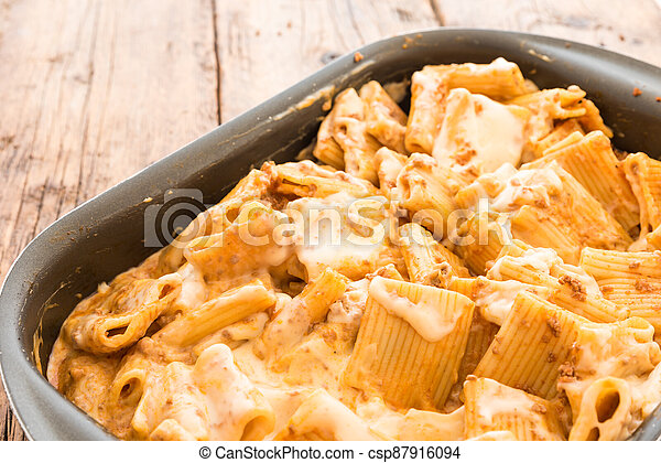 Macaroni with meat baked with cheese - csp87916094