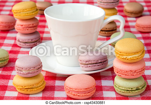 Macaroons and white cup - csp43430881