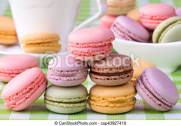 Macaroons with cup of coffee on background - csp43927419
