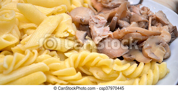 maccaroni with tuna fish pieces and sauce with mushrooms
