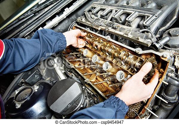 machanic repairman at automobile car engine repair - csp9454947