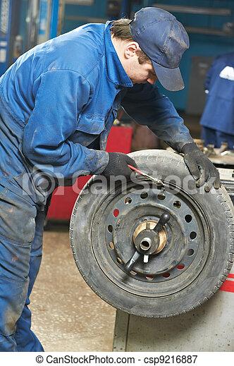machanic repairman at tyre balancing adjustment - csp9216887