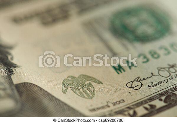 Macro of stamp on dollar banknote - csp69288706
