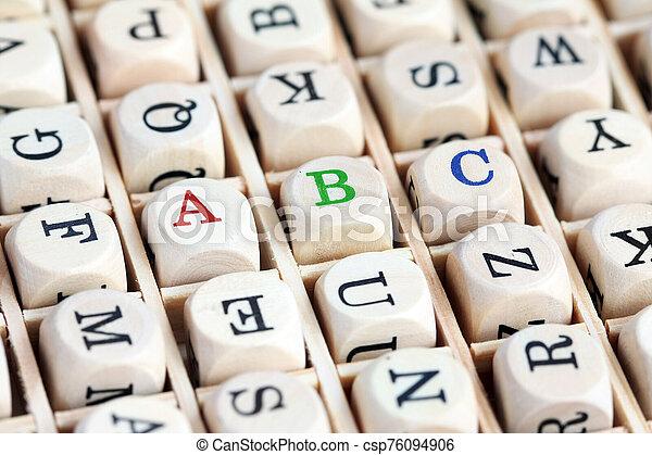 Macro shot of wood alphabet letter blocks - csp76094906