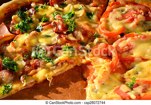 Macro view of tasty pizza on a wooden board - csp28072744