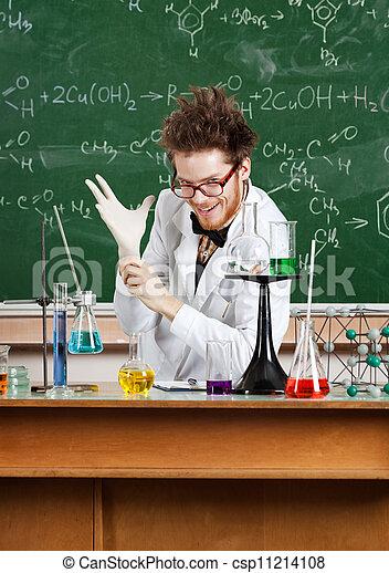 Mad professor puts a medical gloves on - csp11214108