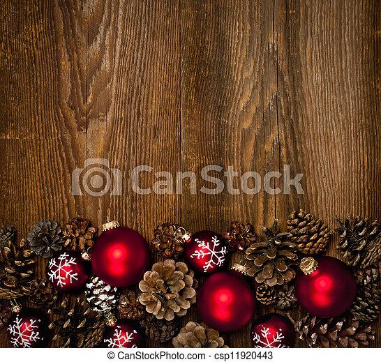 Antecedentes de madera con adornos navideños - csp11920443