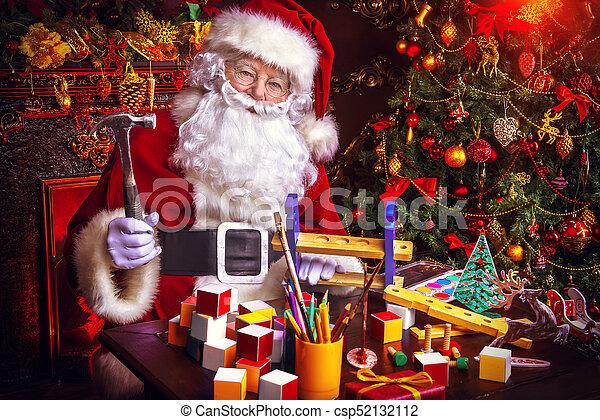 Magic christmas time. Workshop of santa claus. portrait of santa ...
