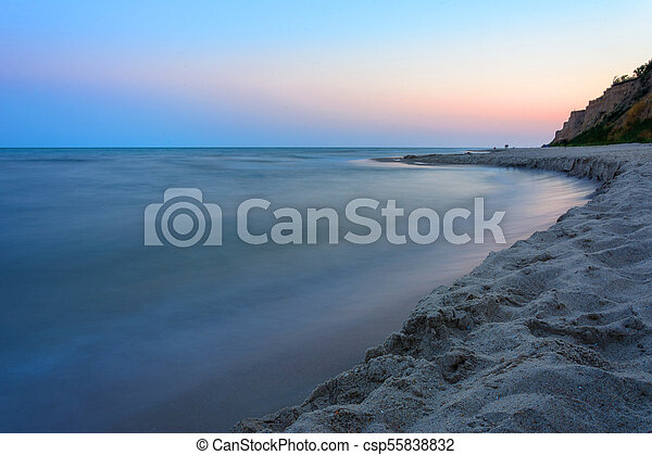 Magic landscape on the shores of the black sea with blurred water - csp55838832