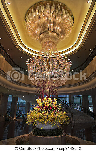 Magnificent huge luster and vase with flowers - csp9149842