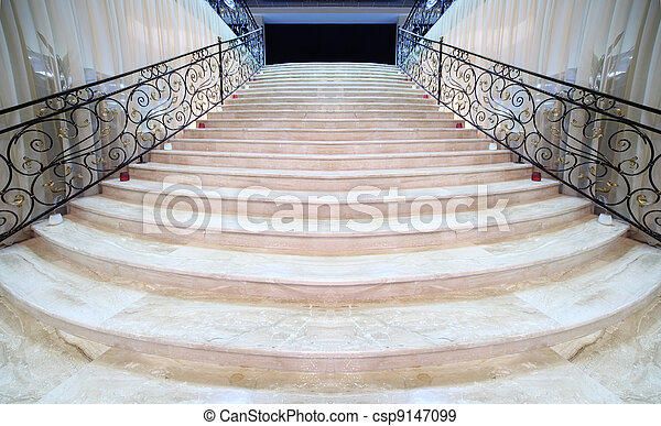 magnificent light marble staircase with ornate metal railings - csp9147099