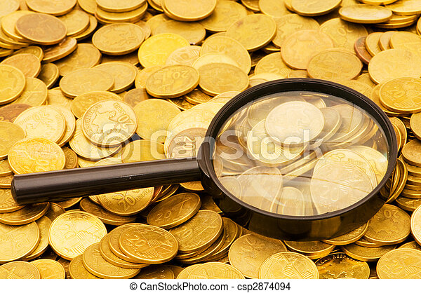 Magnifying glass and lots of gold coins - csp2874094