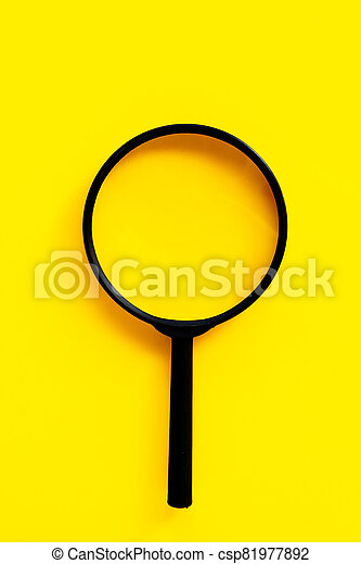 Magnifying glass on yello background. - csp81977892