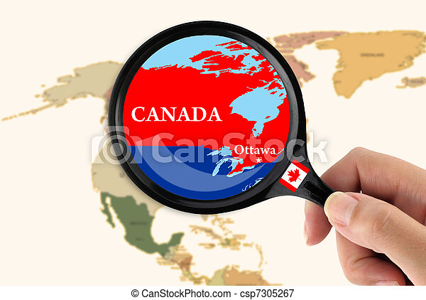 Magnifying glass over a map of Canada - csp7305267