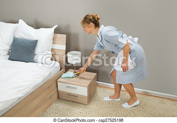 Young Happy Maid Cleaning Dust With Feather Duster In Hotel Room Canstock
