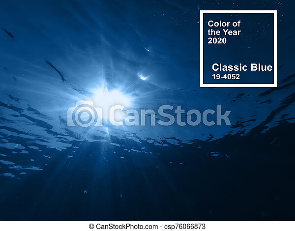 Main color trend 2020 classic blue pantone. depths of the sea with sun rays through the water - csp76066873