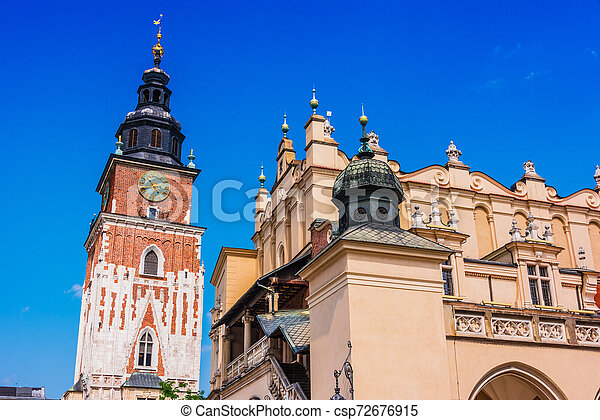 Main Market Square with Town Hall Tower in Krakow, Poland - csp72676915