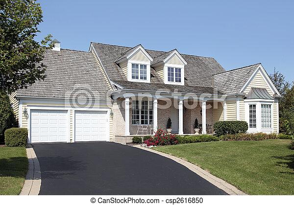 Maison double colonnes garage maison garage for Maison garage double