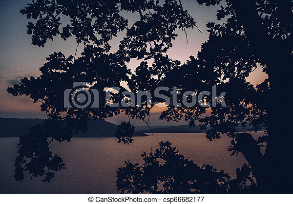 Majestic sunset in the mountains landscape over a calm lake - csp66682177